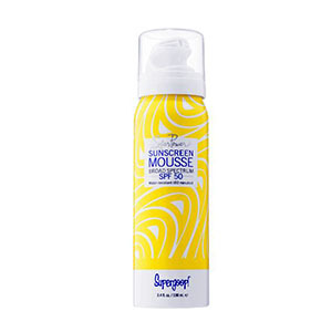 Yellow can of sunscreen mousse by Supergoop! photo