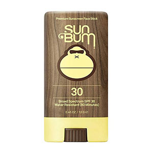Brown and yellow sunscreen stick by Sun Bum photo