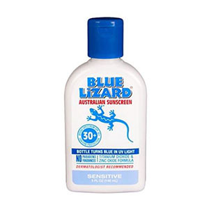 White bottle of sunscreen with blue cap photo