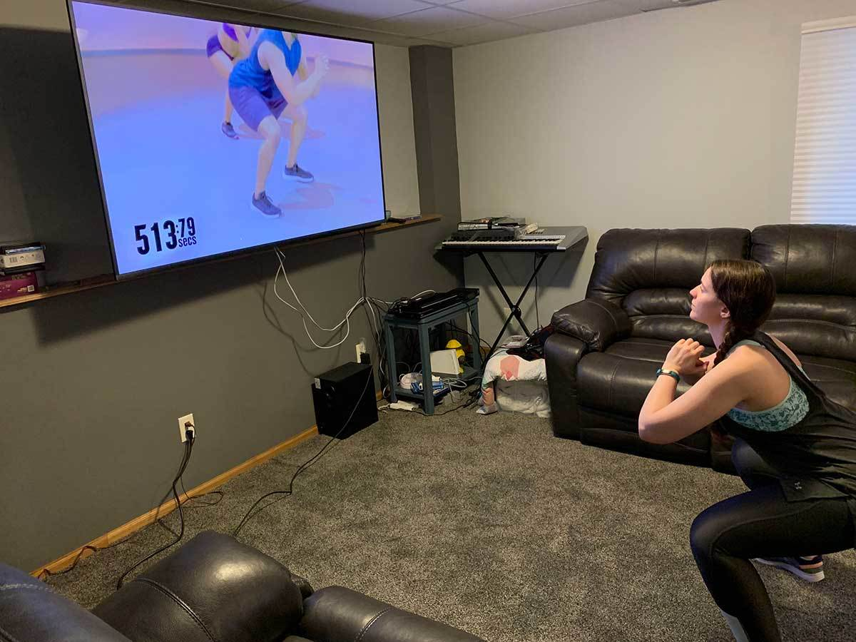 Writer Anna Knief following along to a 600 Secs workout video from home photo