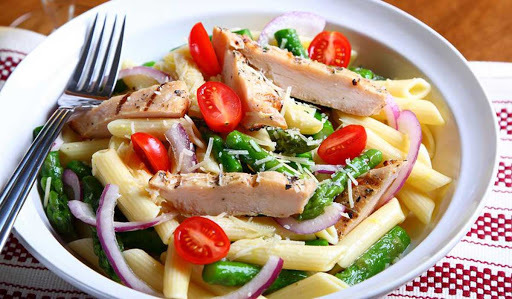 Meal from Openfit platform - penne pasta with grilled chicken, tomatoes, onions, and asparagus photo