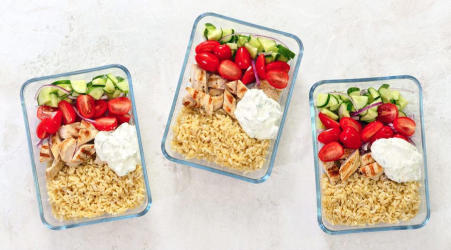 Meal prep containers filled with food. photo