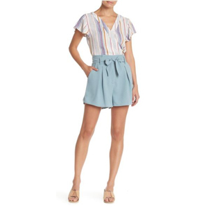 Woman wearing blue paperbag tie waist shorts with a striped blouse. photo