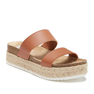 Straw-bottomed sandals with brown leather straps. photo
