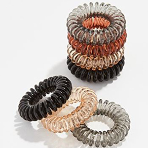 A pack of eight coil hair ties in various colors photo