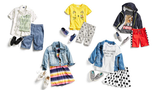 Five children's outfits with a variety of patterns and styles. photo