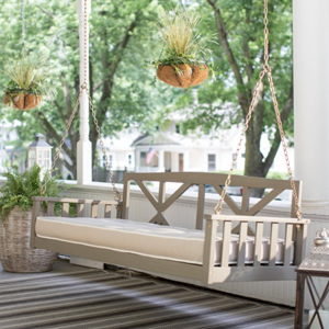 neutral wooden porch swing with cushion photo
