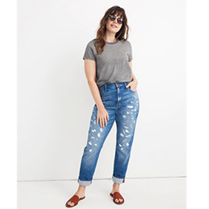 A woman wears high-rise Madewell slim boyjeans with white paint splatters photo