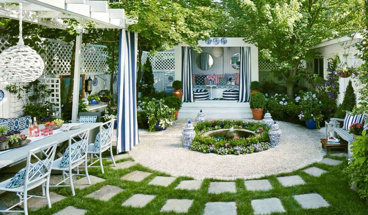 Backyard with three blue and white chairs, marble bar, and white decor photo
