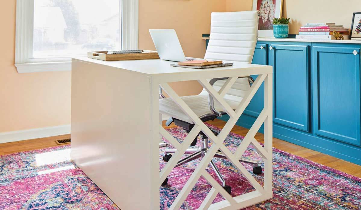 Cutout white desk with white chair and blue cabinets photo