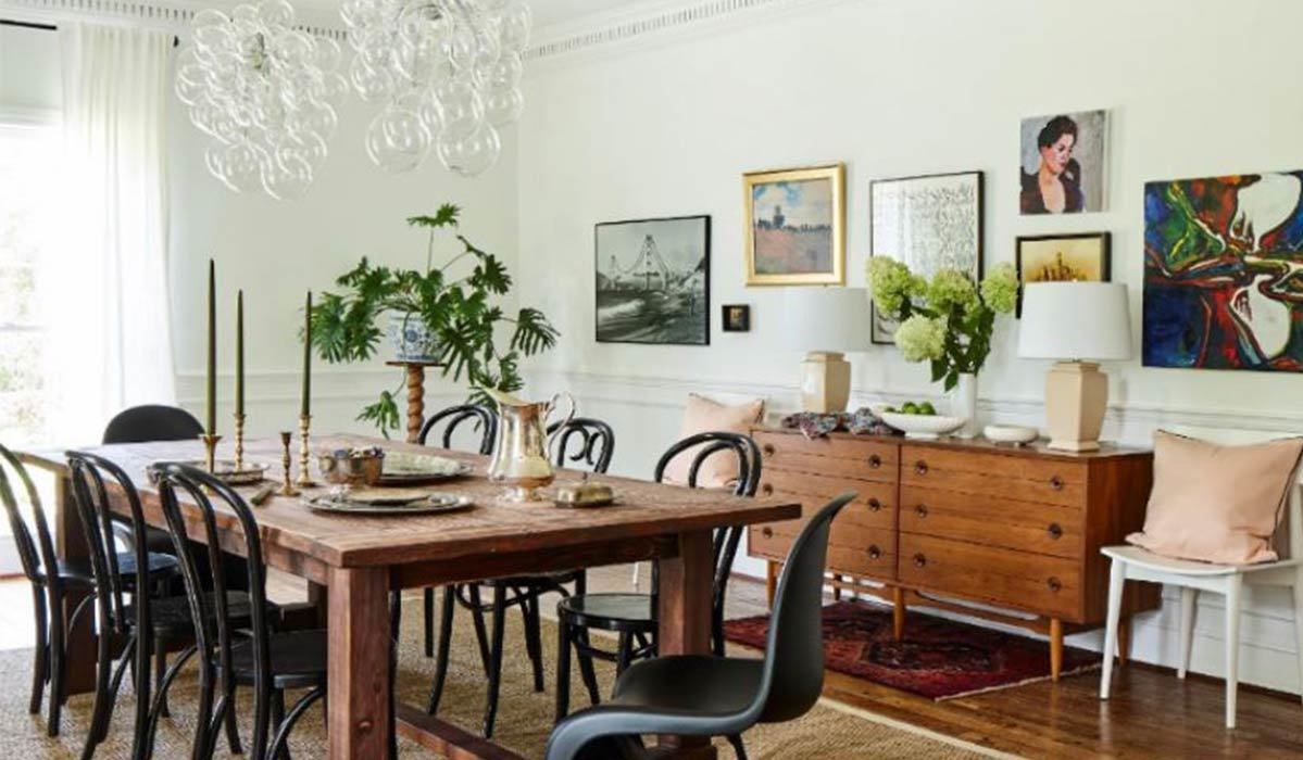 Wood dining table with black chairs and a wood dresser photo