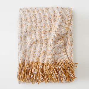 Red, orange, and white throw blanket with fringe photo