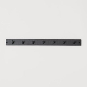 Black wooden hanger with seven pegs photo