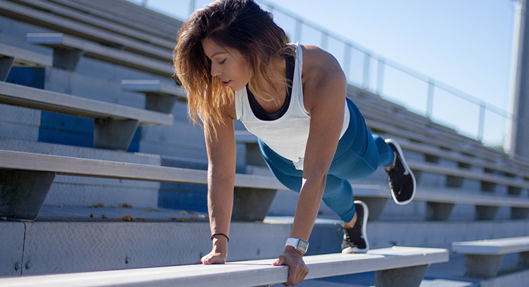 Woman working out on a bleacher