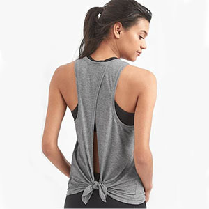 Woman wearing grey tank top tied in the back photo