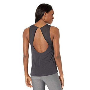 Woman wearing a tank top with an open back photo