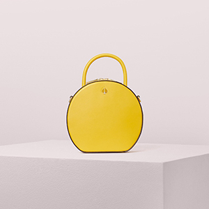 Woman in a white long sleeve with a yellow purse photo