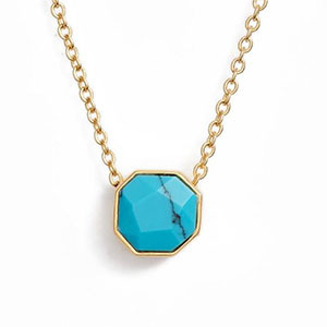 Blue gemstone on a gold necklace photo
