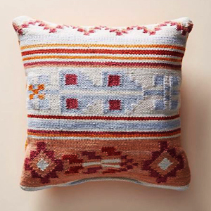 Handwoven outdoor pillow featuring a colorful pattern photo