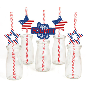 Chevron stripe paper stripes with festive paper cut outs in glass bottles. photo