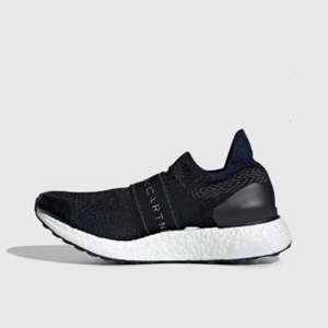 Black and white Adidas shoes from Bandier photo