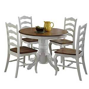 White and brown wood round table and four chairs photo