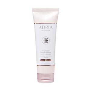 Adria By Thalia conditioner in a white, pink, and rose gold bottle. photo