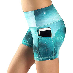 Blue galaxy spandex shorts with a phone in the pocket photo