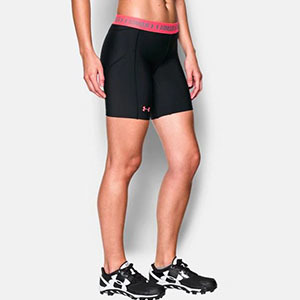 Woman wearing black spandex shorts with pink accents photo