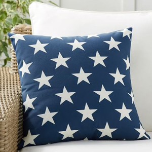 Blue throw pillow with white stars on it photo