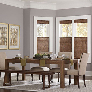 Dining room with woven wood shades photo