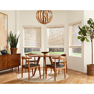 Dining room with white wood blinds photo