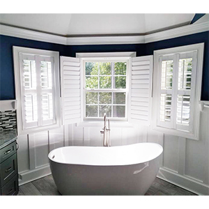 Bathroom with white composite shutters photo
