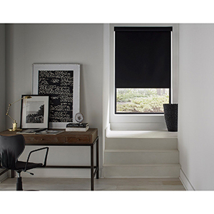Home office with a black vinyl roller shade photo