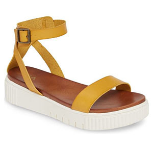 Yellow platform sandals with white soles photo