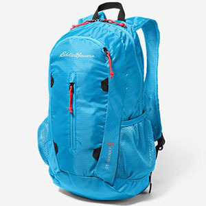 Bright blue backpack with red accents photo