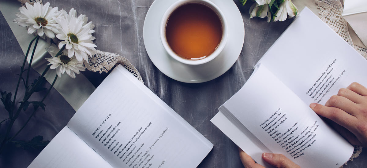 Two books and a coffee cup photo