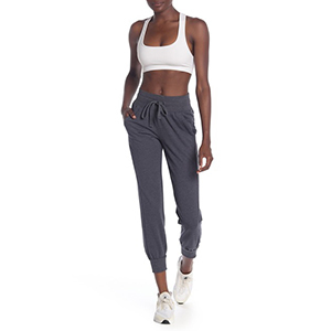 A woman wears a pair of gray joggers photo