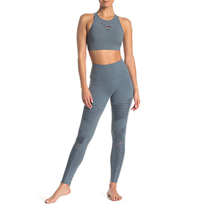 A woman wears gray leggings with mesh inserts photo