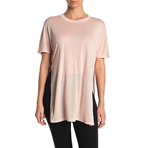 A woman wears a light pink shirt with slits down each side photo