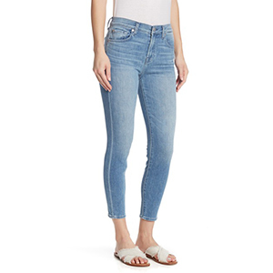 A woman wears 7 For All Mankind light-wash skinny jeans photo