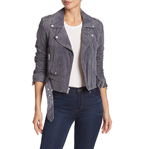 A woman wears a gray suede Andrew Marc motorcycle jacket photo