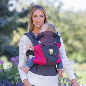 Woman wearing a purple and pink baby carrier with a baby photo