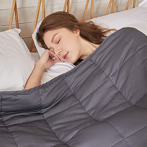 Blue Blanket with woman sleeping photo
