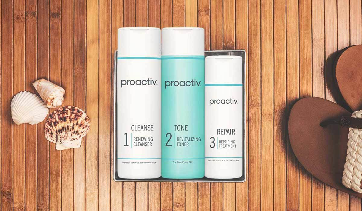Three bottles of Proactiv against a wood background