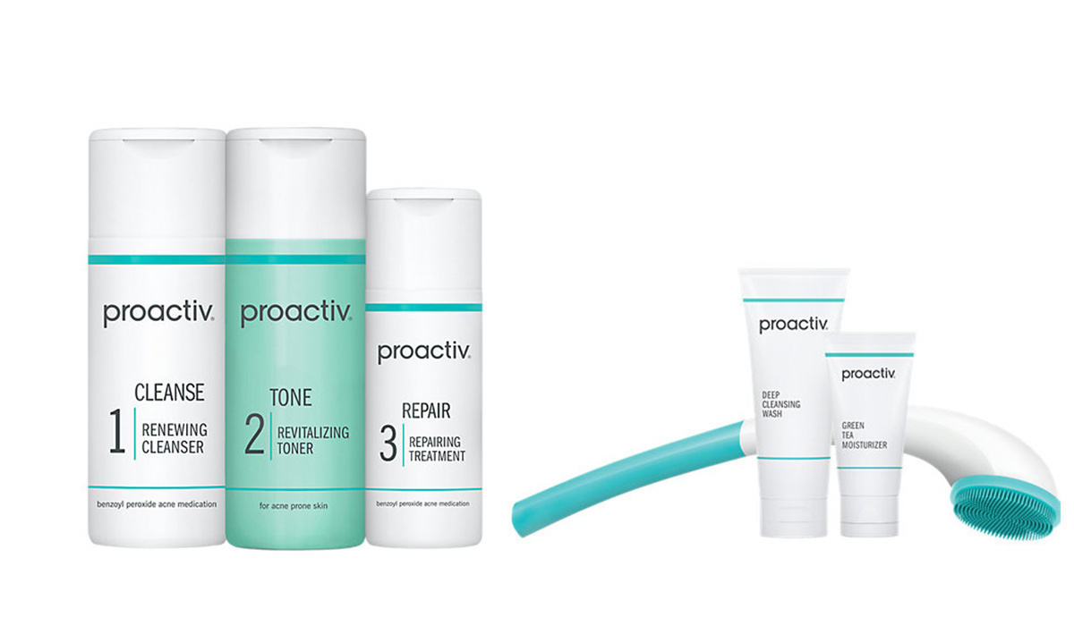Three bottles of Proactiv with two smaller tubes and a back cleaner photo