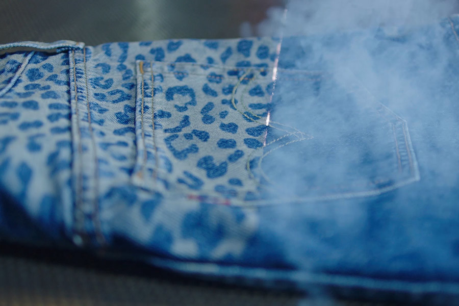 A pair of Levi's jeans customized with leopard print photo