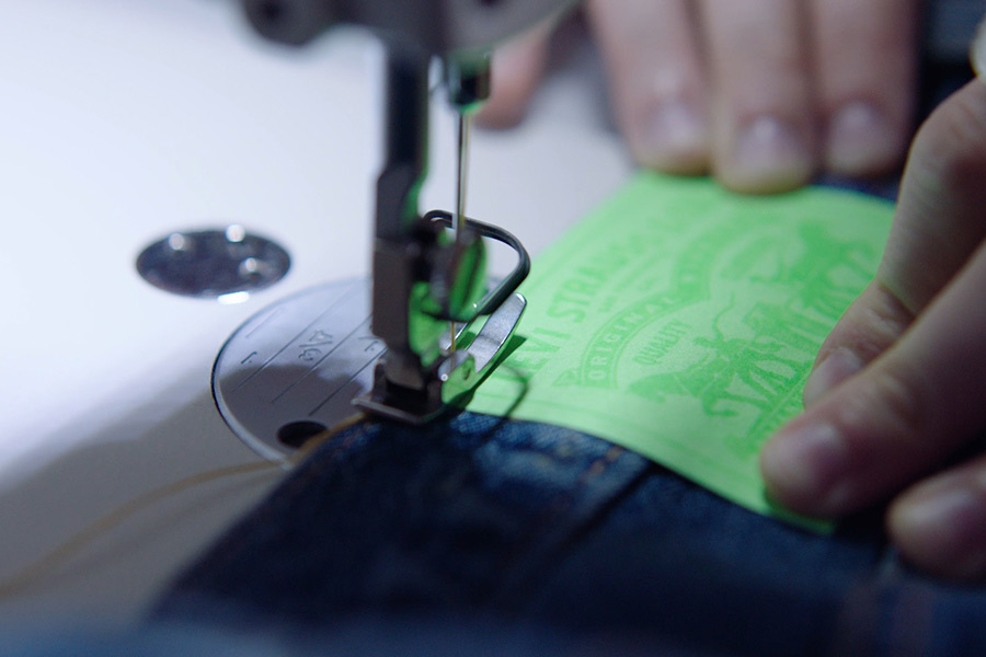 A green back patch is sewn onto a pair of Levi's jeans photo