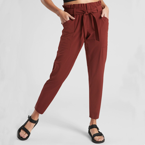 rust joggers with a bow belt photo