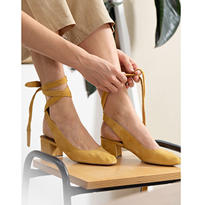 Yellow suede lace-up heels photo